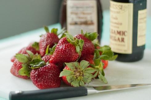 strawberries, honey, balsamic vinegar, and a sharp knife